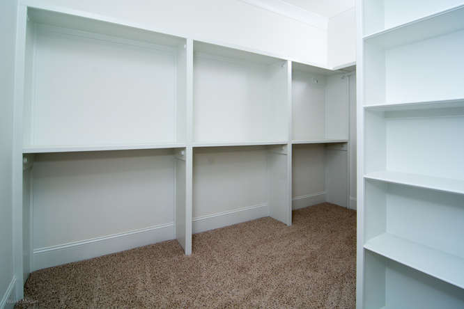 Walk-in closet with built-in shelves