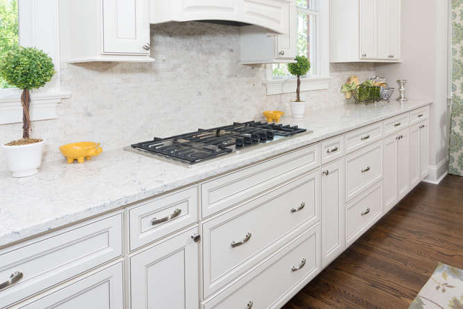 White kitchen counters in a River District Home at Saluda River Club Community.
